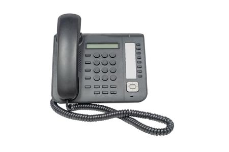 Modern desktop telephone over white background.