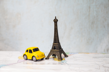 photo of colorful , Eiffel Tower shaped souvenir and car shaped toy on the wonderful  background. Zdjęcie Seryjne