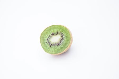 Ripe whole kiwi and half kiwi fruit on white background. Zdjęcie Seryjne