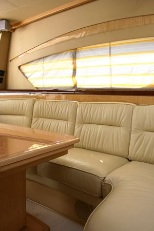 This is a yacht interior with sofa and table photo