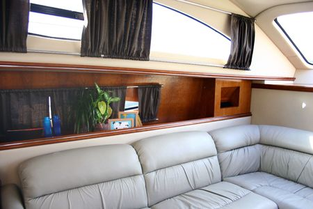 Soft leathern sofa in the yacht photo
