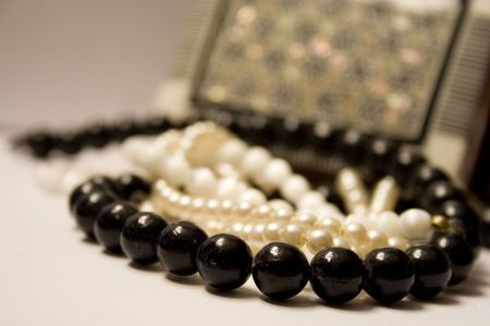 This is a case with jewellery, beads and pearl photo