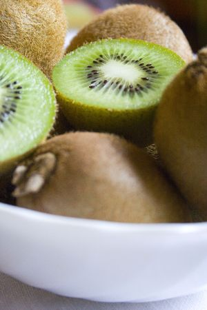 opalescent: Delicious kiwis on the white plate Stock Photo