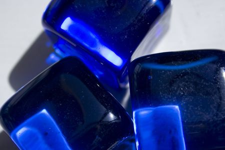 cubical: This is a blue glass of cubical shape