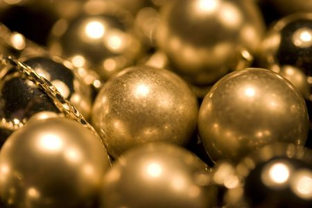 These are gold glossy and matt balls on chain photo