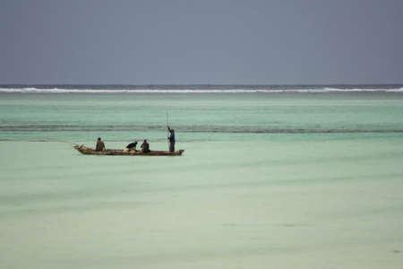 Paje, Zanzibar, Tanzania, September 30, 2010 - Fishermen in Indian Ocean