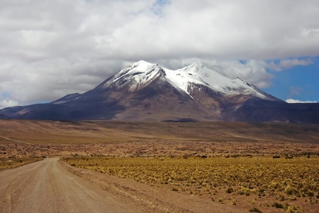 Volcano Miniques seen from the North, situated in Los Flamencos National Reserve, Chile photo