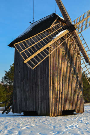 Old windmill in winter photo