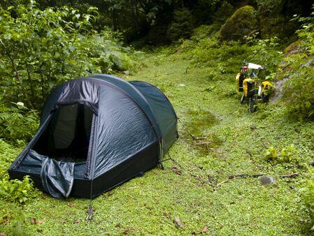 swanetia: Big green tent and bicycles. Swanetia in Georgia. Stock Photo