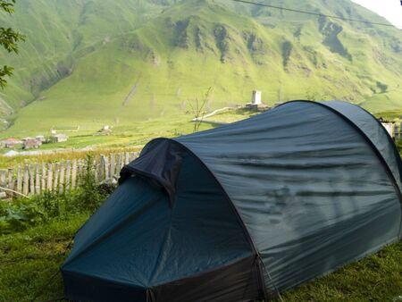 ushguli: Green tent in Ushguli. Sunny summer day. Stock Photo