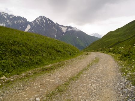 swanetia: Caucas mountain view. Swanetia Ushguli, Georgia. Summer day dark clouds. Rocky path Stock Photo