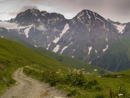 swanetia: Dark clouds small mountain path to ushguli. Swanetia Georgia. Stock Photo