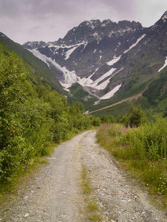 swanetia: Rainy day dark clouds small mountain path in Caucas. Swanetia Georgia. Stock Photo