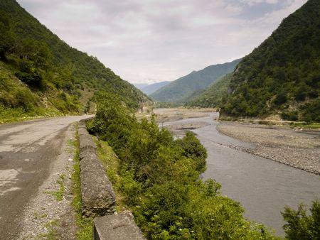 caucas: Small asphalt route and river in mounatin - Caucas Georgia
