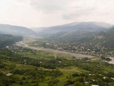 caucas: Big green valley in Georgia, Caucas. Cloudy day.