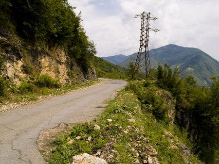 swanetia: Narrow asphalt route  in mountain - Georgia, Caucas