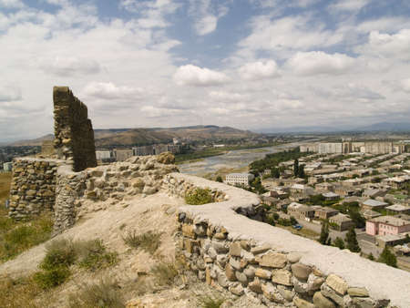 Old wall and aerial view on Gori city of Stalin - Georgia. Summer day Stock Photo - 4821149