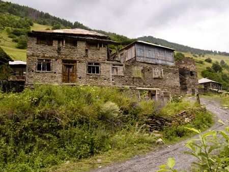 swanetia: Big brick house on the hill in Swanetia, Georgia Caucasus mountain Stock Photo