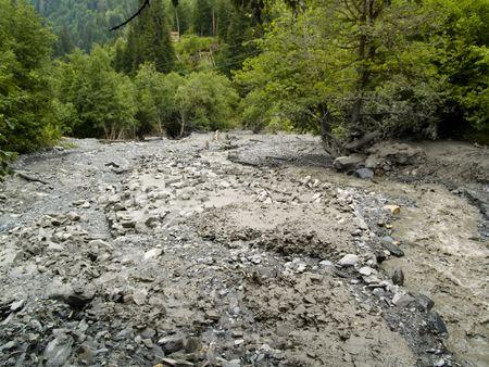 swanetia: River on the mountains road. Mud avalanche - Georgia, Swanetia