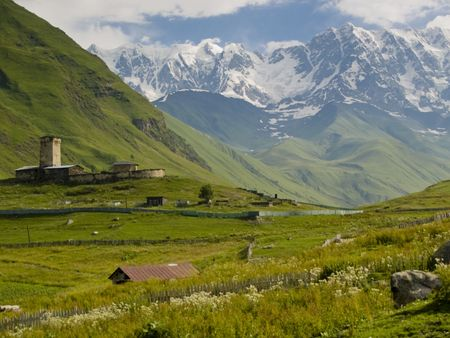 archtecture: Ushguli beauty small village in georgia. Big mountains green grass. Beauty place. Stock Photo