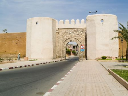 Wall and small city gate in Marrakesh, Morocco. photo