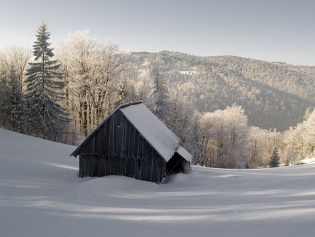 Wooden cottage a lot of snow. Winter sunny day Stock Photo - 4913937