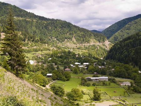Small village in valley in Swanetia Caucasus region in Georgia Stock Photo - 4923450