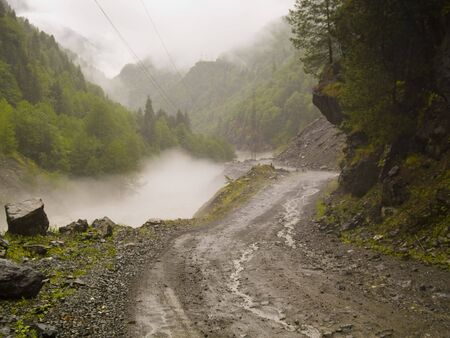 Foggy day danger route in Swanetia region - Georgia Caucasus Stock Photo - 4965347