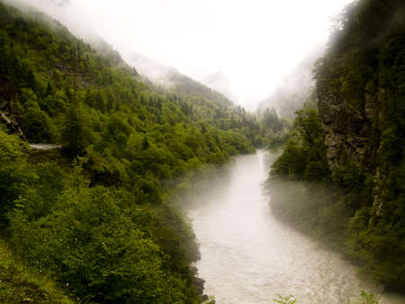 clay stone road in jungle: Foggy rainy day. Georgia - Caucasus Swanetia region