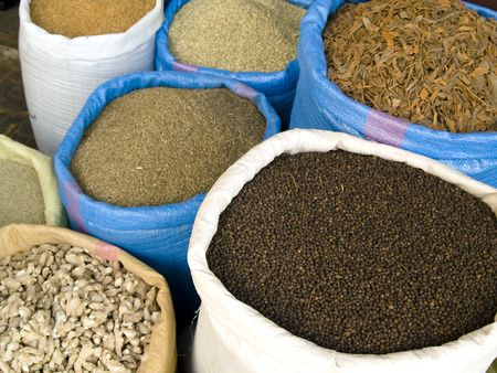 Big bag with spices on the market place in Morocco photo