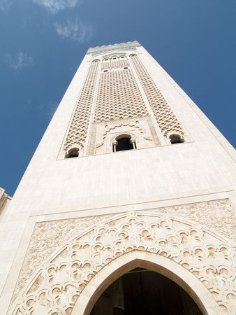 Tower of mosque in Casablanca. Blue sky summer day.