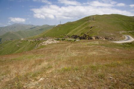 Mountain scenery in Armenia, route green meadows and blue sky. Stock Photo - 5432429