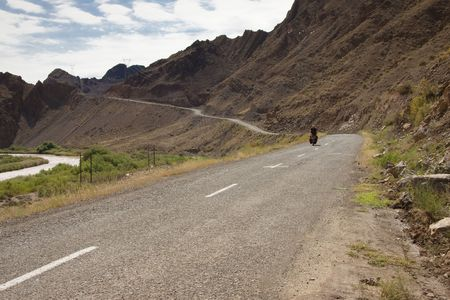 aras: Man on the bicycles in Iran. Aras river and mountain. Border with Azerbijan