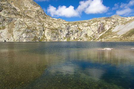 vacance: Pedourres lake in Andorra, Pyrenees mountain, summer day Stock Photo