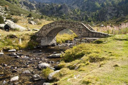 Stone bridge over beautiful river in summer - Pyrenees