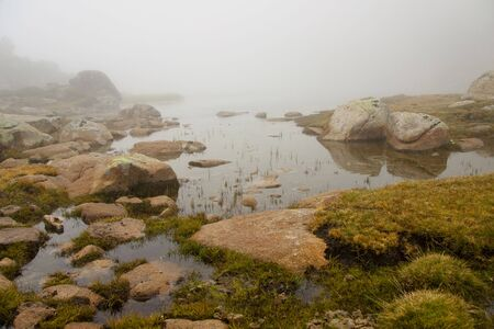 Foggy day, small lake in Andorra - Pyrenees. photo
