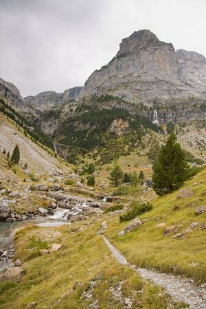 Mountain path near River Bellos in big Canyon Anisclo  - Ordesa Nation Park in Pyrenees, Spain.Autumn sunny day. photo