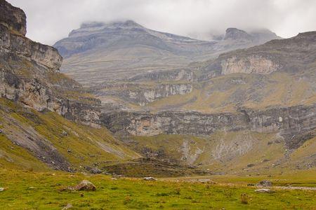 Ordesa valley - National spanish mountain park. Dark cloudy and rainy day. View to monte Perdido. Rainy day. photo
