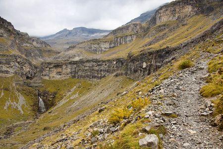 perdido: Ordesa park in Spain - National park. Small path to monte Perdido. Rainy day.
