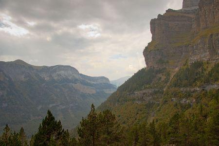 Autumn cloudy dark and rainy day in Ordesa National Park - Spain. photo