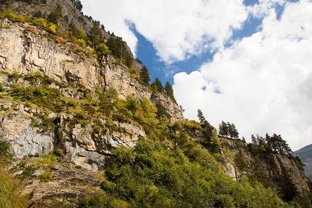perdido: Ordesa National park. Blue sky, white clouds, pattern wall. Stock Photo