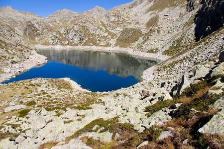 Sunny day, blue sky, mountain lake in Aiguestortes National Park. Stock Photo - 6967183