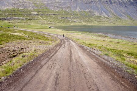 Empty gravel route to Dynjandi waterfall on Iceland in Westfjords. photo