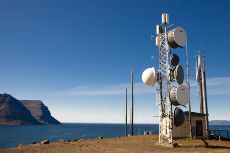 Cell tower on Arnarnes in background Isafjardardjup - Iceland. Stock Photo