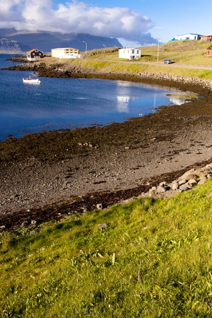 Beauty landscape, blue bay, green grass, Djupivogur village - Iceland photo