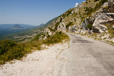 Narrow danger route in Montenegro near Skadarsko lake - Balkans photo