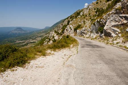 Narrow danger route in Montenegro near Skadarsko lake - Balkans photo