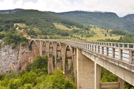 Old Bridge on Tara river near Durdevica. Monetenegro. Stock Photo