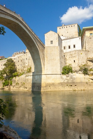 View on old town of Mostar from under bridge. Unesco city. Bosnia and Herzegovina. photo