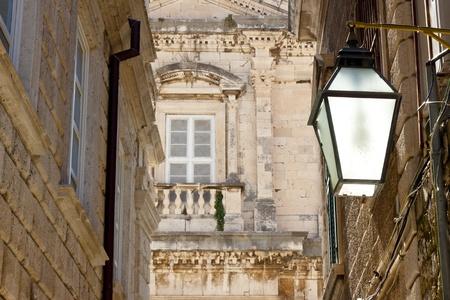Typical street in Dubrovnik - old lamp. Balkans, Croatia. photo